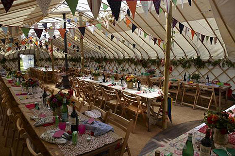 Inside a yurt laid out for a wedding – image courtesy of Cheltenham Yurt Hire