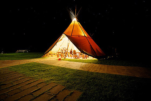Tipi at night – image courtesy of Event in a Tent