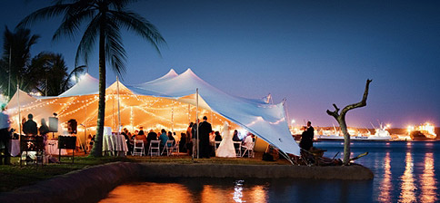 A stretch tent next to the water – image courtesy of The Stretch Tent Company