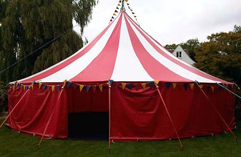 A big top in use in a garden – image courtesy of Bigtopmania