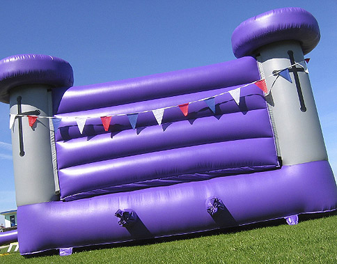 Bouncy castle hire; Purple and Grey Bouncy Castle with Bunting