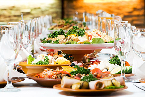 Caterers; buffet on table with wine glasses