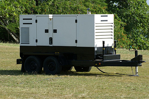 Generator Hire; event generator situated on grass