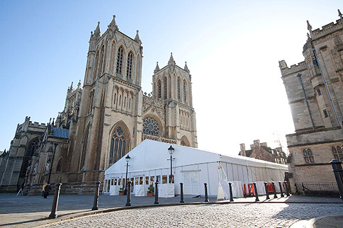 Marquee hire; marquee on hard ground, next to a cathedral – image courtesy of Danco Plc