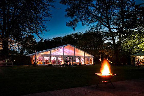 Marquee hire; marquee at night – image courtesy of Alresford Marquees