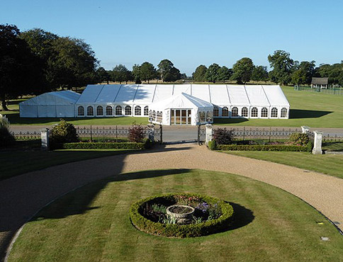 Hiring a marquee in the garden of a country house, courtesy of Anglia Coastal Marquees