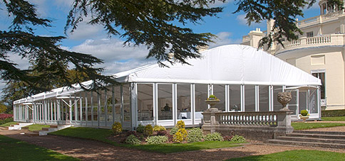 Hiring a marquee with a curved roof, courtesy of Savoir Faire